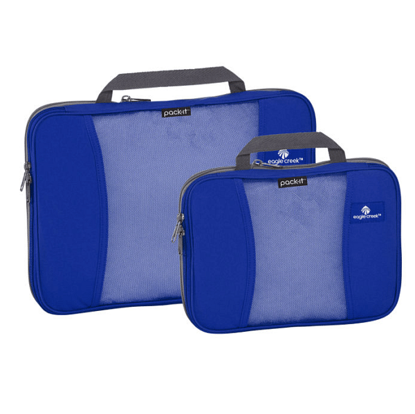 Two blue packing cubes. They're not actually cubes. They are rectangular and shaped like a briefcase but smaller, with a small cloth handle at the top.