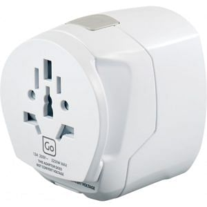 The adapter is white and more or less in the shape of a cube. It has a number of holes at the near end, where a plug from anywhere in the world can be inserted. The USB ports are not visible in this photo.